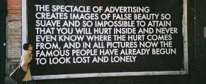 Photo: Billboard critiquing advertising. Text by Robert Montgomery.