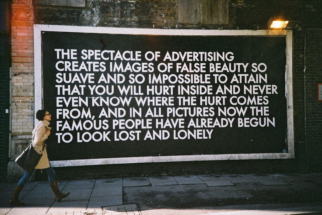 Photo: Prophetic, by Brett Jordan. Billboard and text by Robert Montgomery. (photo on Flickr | HuffPo article on Montgomery)