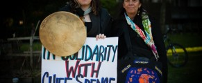Two women holding signs at an Idle No More march in Coast Salish territories, January 11, 2013