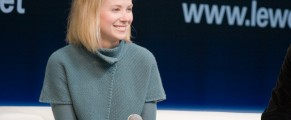 Photo of Marissa Mayer holding a microphone, onstage at Le Web 2008