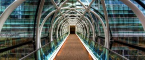 Architectural photo of a glass walkway between buildings