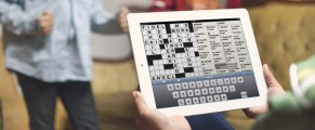 Picture of someone playing the NYT Crosswords app on an iPad